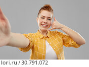 Купить «teenage girl taking selfie making calling gesture», фото № 30791072, снято 28 февраля 2019 г. (c) Syda Productions / Фотобанк Лори