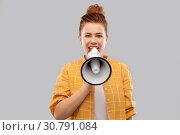 Купить «red haired teenage girl speaking to megaphone», фото № 30791084, снято 28 февраля 2019 г. (c) Syda Productions / Фотобанк Лори