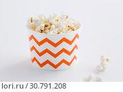 Купить «close up of popcorn in disposable paper cups», фото № 30791208, снято 6 июля 2018 г. (c) Syda Productions / Фотобанк Лори