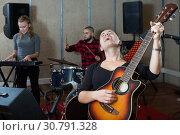 Купить «Adult guitar player and singer with band», фото № 30791328, снято 26 октября 2018 г. (c) Яков Филимонов / Фотобанк Лори