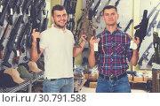 Купить «Men choosing air weapon», фото № 30791588, снято 4 июля 2017 г. (c) Яков Филимонов / Фотобанк Лори