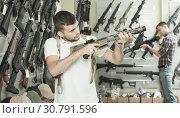 Купить «Men choosing air weapon», фото № 30791596, снято 4 июля 2017 г. (c) Яков Филимонов / Фотобанк Лори