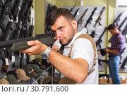 Купить «Men choosing air weapon», фото № 30791600, снято 4 июля 2017 г. (c) Яков Филимонов / Фотобанк Лори