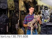Купить «Male customer choise camouflage bag», фото № 30791608, снято 4 июля 2017 г. (c) Яков Филимонов / Фотобанк Лори