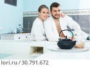 Купить «Couple drinking tea in spa center», фото № 30791672, снято 24 апреля 2018 г. (c) Яков Филимонов / Фотобанк Лори