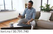 Купить «male blogger with keyboard videoblogging at home», видеоролик № 30791740, снято 26 апреля 2019 г. (c) Syda Productions / Фотобанк Лори
