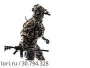 Купить «Army Ranger in field Uniforms with weapon, plate carrier and combat helmet are on, his face closed by Shemagh Kufiya scarf. Studio shot.», фото № 30794328, снято 19 ноября 2016 г. (c) age Fotostock / Фотобанк Лори