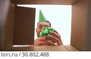 Купить «happy man opening parcel box or birthday gift», видеоролик № 30802488, снято 15 мая 2019 г. (c) Syda Productions / Фотобанк Лори