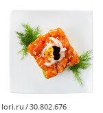 Купить «Cube of delicious salmon tartare garnish with avocado on plate at cafe», фото № 30802676, снято 23 октября 2019 г. (c) Яков Филимонов / Фотобанк Лори