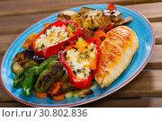 Купить «Baked vegetables, grilled chicken breast», фото № 30802836, снято 17 июля 2019 г. (c) Яков Филимонов / Фотобанк Лори