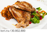 Купить «Tasty cooked fried pork chop with lentils, herbs and berries garnish at plate», фото № 30802880, снято 21 сентября 2019 г. (c) Яков Филимонов / Фотобанк Лори