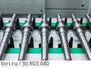 Купить «Metal shafts on the CNC conveyor transfer belt», фото № 30803040, снято 16 мая 2018 г. (c) Андрей Радченко / Фотобанк Лори