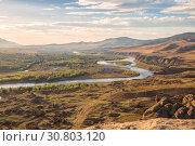 Купить «Beautiful landscape in the evening sunlight. Mtkvari River on the background of the Caucasus Mountains, on the banks of the river ruins of a medieval settlement, Uplistsikhe, Georgia», фото № 30803120, снято 30 сентября 2018 г. (c) Юлия Бабкина / Фотобанк Лори