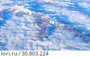 Купить «Beautiful view through airplane window, airplane flying above mountains with clouds», видеоролик № 30803224, снято 18 мая 2019 г. (c) Игорь Жоров / Фотобанк Лори