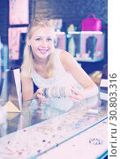 Купить «Woman buying bracelet in store», фото № 30803316, снято 21 мая 2019 г. (c) Яков Филимонов / Фотобанк Лори
