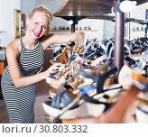 girl choosing pair of shoes in store. Стоковое фото, фотограф Яков Филимонов / Фотобанк Лори