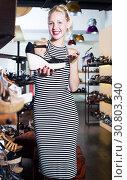 Купить «female customer choosing shoe», фото № 30803340, снято 26 мая 2019 г. (c) Яков Филимонов / Фотобанк Лори