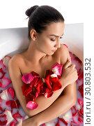 Купить «Gorgeous brunette in bath wth rose petals», фото № 30803532, снято 17 мая 2019 г. (c) Гурьянов Андрей / Фотобанк Лори