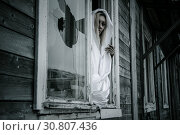 Woman in a white shirt near the window. Стоковое фото, фотограф Art Konovalov / Фотобанк Лори