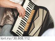 Купить «Accordionist plays vintage accordion», фото № 30808112, снято 18 мая 2019 г. (c) EugeneSergeev / Фотобанк Лори