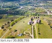 Купить «Panoramic view from drone of the castle Montemor o Novo. The Alcaides palace ruins. Evora district. Alentejo, Portugal», фото № 30808788, снято 20 апреля 2019 г. (c) Яков Филимонов / Фотобанк Лори