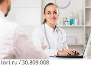 Купить «Smiling woman doctor consultation», фото № 30809008, снято 8 декабря 2019 г. (c) Яков Филимонов / Фотобанк Лори