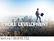 Купить «Agile transformation concept with businessman walking on tight r», фото № 30810732, снято 2 июня 2020 г. (c) Elnur / Фотобанк Лори