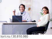 Купить «Old pregnant woman visiting young male doctor», фото № 30810980, снято 21 января 2019 г. (c) Elnur / Фотобанк Лори