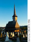 Купить «Image of wooden Biserica in Rozavlea», фото № 30811156, снято 14 сентября 2017 г. (c) Яков Филимонов / Фотобанк Лори