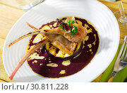 Купить «Baked lamb ribs in wine sauce with eggplant and dried hibiscus», фото № 30811228, снято 23 мая 2019 г. (c) Яков Филимонов / Фотобанк Лори