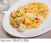 Купить «Omelet with cauliflower», фото № 30811356, снято 15 июня 2019 г. (c) Яков Филимонов / Фотобанк Лори