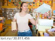Купить «Positive girl chooses accessories for gift», фото № 30811456, снято 19 апреля 2017 г. (c) Яков Филимонов / Фотобанк Лори