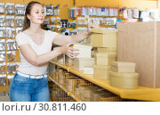 Купить «Cheerful housewife choosing other gift boxes», фото № 30811460, снято 19 апреля 2017 г. (c) Яков Филимонов / Фотобанк Лори