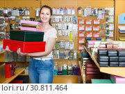 Купить «Happy woman demonstrates multi colored boxes», фото № 30811464, снято 19 апреля 2017 г. (c) Яков Филимонов / Фотобанк Лори