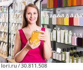 Купить «woman take a choise fresh liquid soap in perfume supermarket», фото № 30811508, снято 2 мая 2017 г. (c) Яков Филимонов / Фотобанк Лори