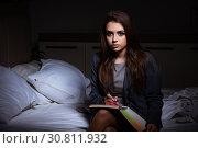 Купить «Tired businesswoman working overtime at home at night», фото № 30811932, снято 5 февраля 2019 г. (c) Elnur / Фотобанк Лори