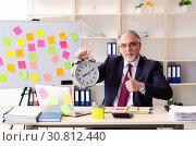 Купить «Aged man employee in conflicting priorities concept», фото № 30812440, снято 25 декабря 2018 г. (c) Elnur / Фотобанк Лори