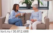 Купить «senior mother and daughter with coffee talking», видеоролик № 30812688, снято 12 мая 2019 г. (c) Syda Productions / Фотобанк Лори