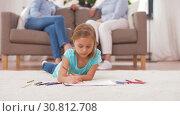 Купить «girl drawing with crayons in sketchbook at home», видеоролик № 30812708, снято 12 мая 2019 г. (c) Syda Productions / Фотобанк Лори