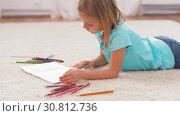 Купить «girl drawing with crayons in sketchbook at home», видеоролик № 30812736, снято 12 мая 2019 г. (c) Syda Productions / Фотобанк Лори