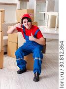 Купить «Young male contractor with boxes working indoors», фото № 30812864, снято 1 февраля 2019 г. (c) Elnur / Фотобанк Лори
