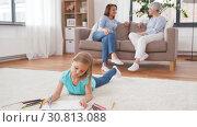 Купить «adults talking and girl drawing at home», видеоролик № 30813088, снято 12 мая 2019 г. (c) Syda Productions / Фотобанк Лори