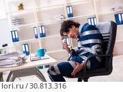 Купить «Young tied male employee in the office», фото № 30813316, снято 18 декабря 2018 г. (c) Elnur / Фотобанк Лори