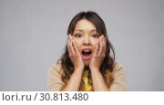 Купить «shocked asian woman with open mouth», видеоролик № 30813480, снято 17 мая 2019 г. (c) Syda Productions / Фотобанк Лори