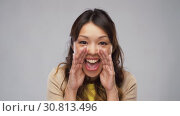 Купить «asian woman shouting or calling for someone», видеоролик № 30813496, снято 17 мая 2019 г. (c) Syda Productions / Фотобанк Лори