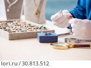 Купить «Young jeweler working in his workshop», фото № 30813512, снято 19 декабря 2018 г. (c) Elnur / Фотобанк Лори