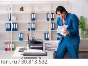 Купить «Young employee making copies at copying machine», фото № 30813532, снято 14 декабря 2018 г. (c) Elnur / Фотобанк Лори