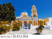 Купить «The Church of St. George in Oia, Santorini, Greece», фото № 30813904, снято 9 июня 2017 г. (c) Наталья Волкова / Фотобанк Лори