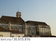 Купить «COIMBRA, PORTUGAL - August 13, 2016: Tourists explore the ancient palace which is part of the historic university city of Coimbra, Portugal.», фото № 30815816, снято 13 августа 2016 г. (c) age Fotostock / Фотобанк Лори