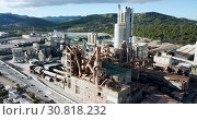 Купить «View from drone of cement plant industrial area, Catalonia, Spain», видеоролик № 30818232, снято 25 декабря 2018 г. (c) Яков Филимонов / Фотобанк Лори